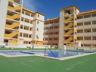 Ground floor apartment with large patio, communal pool