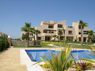 Ground floor apartment, patio, pool views, communal pool, parking