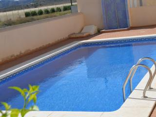 Front line, ground floor apartment, large patio, communal pool
