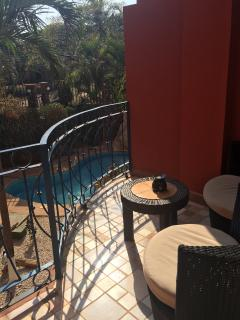 Read and relax with a nice drink on the balcony overlooking the courtyard and pool.