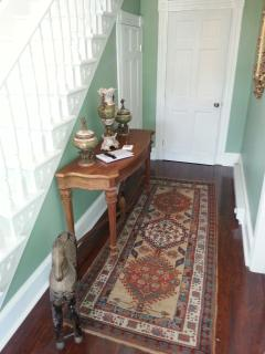 The well-appointed front hallway shared between the two private guest suites.