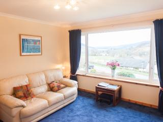 Lounge with panoramic view towards Loch Ness