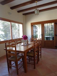 beautiful characterful indoor mediterranean dining area with fantastic picture window