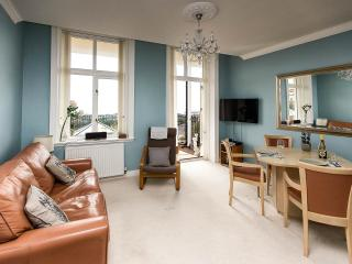 Bright living room with direct access onto terrace & dining area.