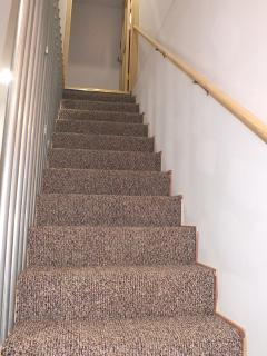 stairway to the huge master bedroom