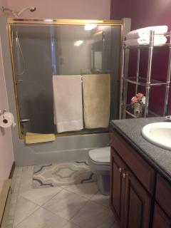 One bath with two access entrances.  One from the main rooms and one from the master bedroom.