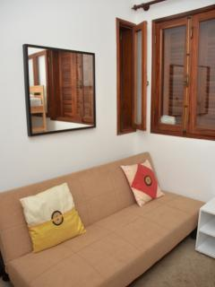 Bedroom 2 with Aircon, bunk beds, and a sofa bed.