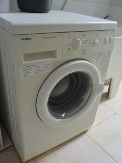 Washing machine in the laundry area.