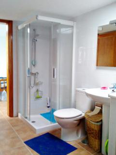 bathroom access for middle & rear bedrooms with washing machine,  fridge