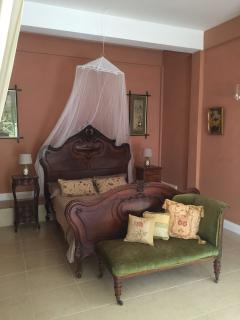 Bedroom with antique French bed and furniture