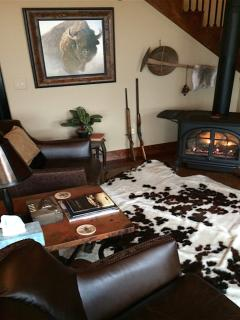 An evening fire, high gloss floors, beautifully decorated, HDTV, furs, and warm leather furnishings