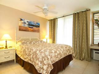 Queen bed with air conditioner in the bedroom