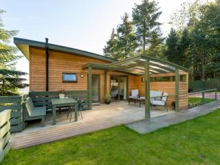 back deck of lodge with private parking