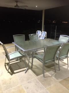 Outdoor dining with lake view in background taken at night