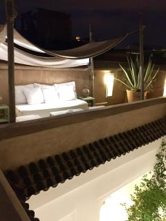 The top of the Koutoubia Mosq shines in the night of Marrakech from our terrace