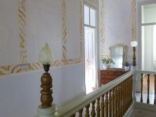 Bright and airy hallway with original stucco paint work