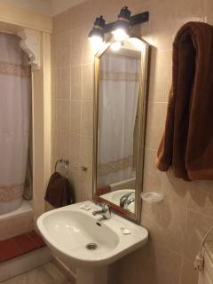 Bathroom with hairdryer. towels included