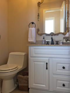 PowderRoom:Located inside entrance at base of stairs ,Toilet, sink, basic toiletries, Quality towels