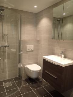 Bathroom with floor heating and washingmachine