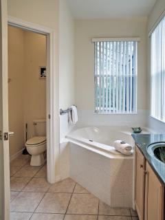 This spacious bathroom has plenty of room