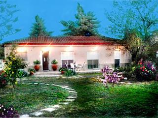 Cottage house with beautiful gardens, Larisa