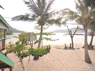 From Beach View balcony out to the beach to swim or wallow in warm waters..