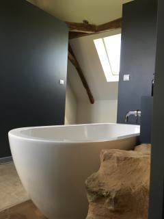 Free-standing bath in bedroom 1's bathroom