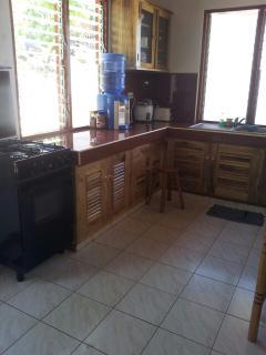 Fully equiped kitchen, stove, fridge with freezer.