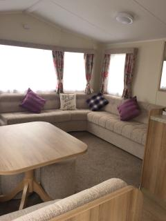 Open plan living and dining area with hide-away sofa bed and comfortable seating all round!