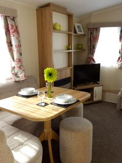 Spacious open plan living area with LED TV, DVD/CD player, FREE Wi-Fi, dvd's and a pack of cards too