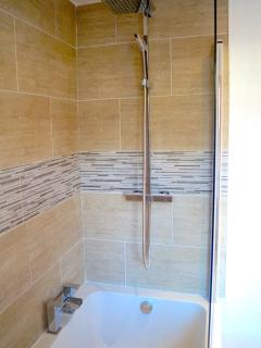 Bathroom with big bath and good shower.