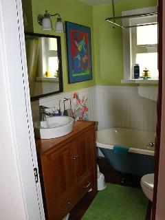 main floor bathroom, with clawfoot tub and shower combination