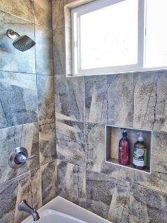 Tiled bath enclosure.