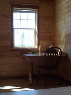 Interior of guest cabin has built-in table.