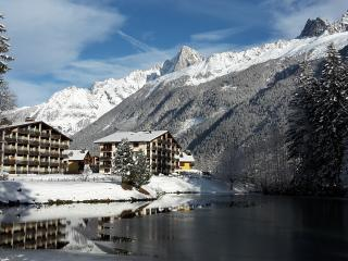 View of the building from across Lac des Gaillands, with l'Aiguille Verte in the background.