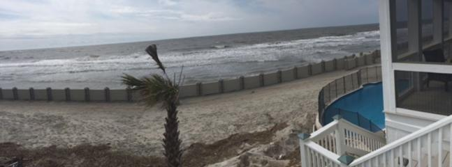 Current photo of pool/beach at high tide