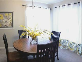 Dining area with patio access and view