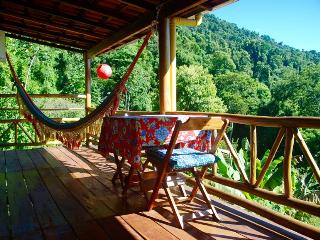Chalé Amarelo- Yellow cottage at Casa Tambor. Nice balcony with hamack, table and chairs.