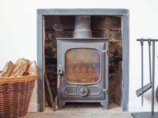 The wood burning stove in Solent Cottage