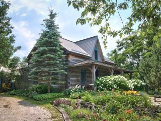 A magical log cabin set on 23 acres of forest, gardens and meadows for complete privacy.
