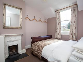 The second bedroom - original fireplace and sash window.