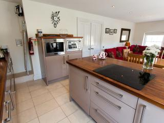 The kitchen is light and airy with large windows