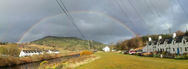 Rainbow over canal and cottages