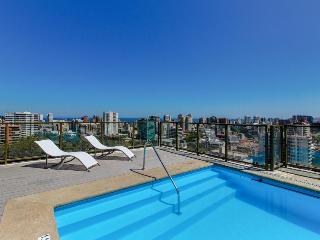 Modern condo with cityscape views & community gym near beach. Shared pool!