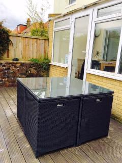 Patio with 8 seater cube outdoor dining set.