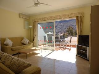 Large Lounge. Spacious terrace with nice outside dining area. Views to valley and port.