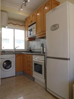 Modern kitchen. Full sized oven and hob, fridge/freezer, plenty of utensils, china and cutlery.