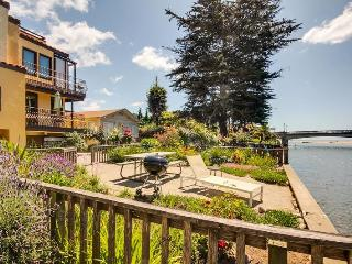 Enjoy the riverside picnic area in front of this beach house.
