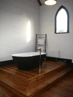 Free standing bath on part of the original stage.