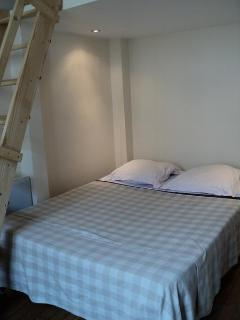 Double bed and access to mezzanine level with one regular single bed.
